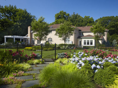 This overflowing stepping stone garden walk sets the tone for the space as you pass through on your way to the pool.