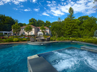 The destination free form pool is a natural oasis that envelops you in lush gardens.