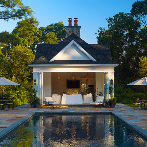 Poolside cabana with full width accordion doors to allow for a cool cross breeze.