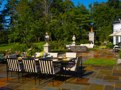 Outdoor rooms with New York Bluestone paving create different opportunities for entertaining across the entire rear of the residence.