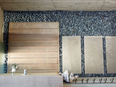 Stone, concrete and wood create a serene outdoor shower.
