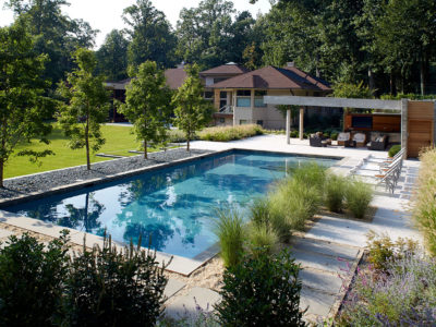 Digging the pool area into the hillside maximized a play lawn area.
