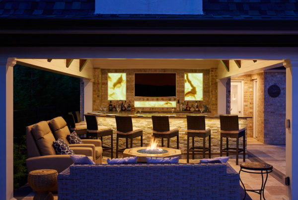 Covered fire lounge in Roslyn Heights with firepit