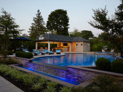 Pool lighting that accents planting and infinity edge at night